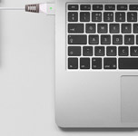 TUDIA Klip for MacBook Charger attached to MacBook