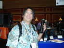 Brian Chee, Infoworld at Jadoo's Booth Holding Fuel Cell