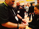 Arlan Levitan Shows Magic Tricks to Rand Peterson at the Kidz Gear Booth at Showstoppers
